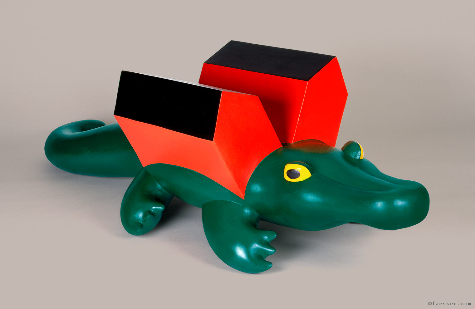 Formerly inflated crocodile extended with two houses; artist Roland Faesser, sculptor and painter 1994
