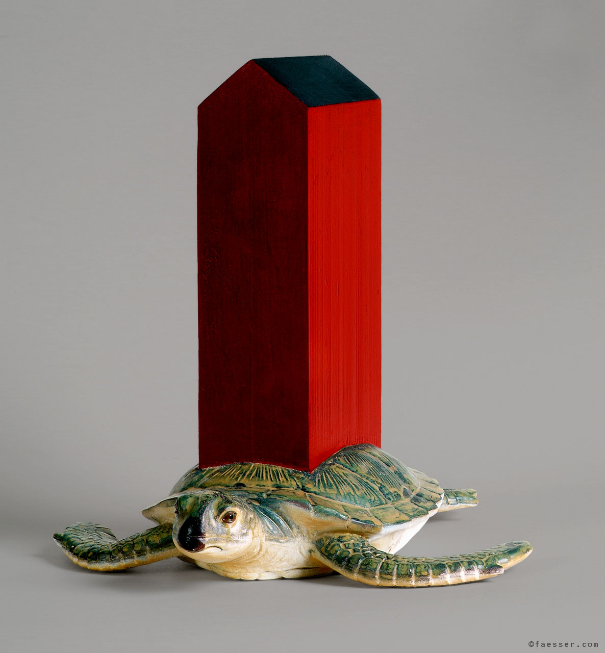 A turtle is carrying a house on his shell; artist Roland Faesser, sculptor and painter 1998
