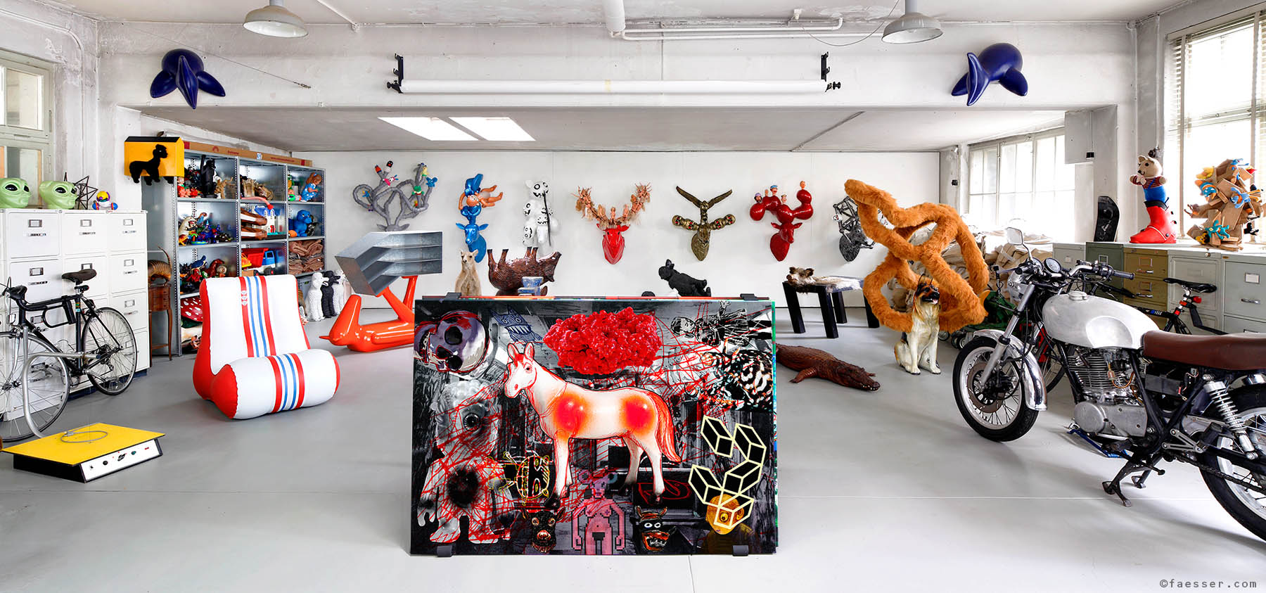 Gallery with trophies, sculptures and a digital painting at studio Zurich; works of art as figurative sculptures and digital paintings; artist Roland Faesser, sculptor and painter 2011
